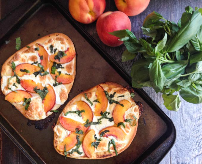 cookie sheet with peach basil flatbread pizzas with fresh basil & peaches