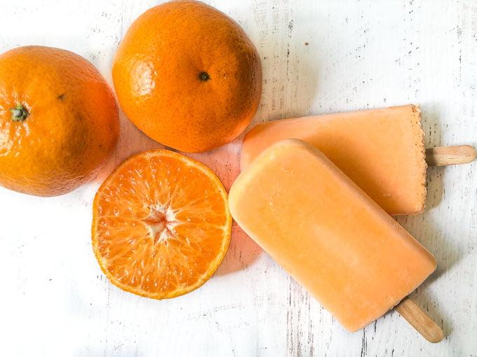 orange low carb jello pop with fresh oranges in background