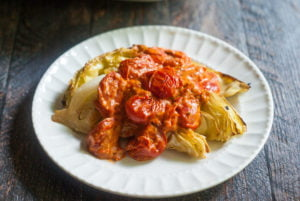 This roasted cabbage with creamy tomato sauce reminds me of a decadent pasta dish. The flavorful tomato sauce tops the sweet roasted cabbage for a great vegetarian meal.