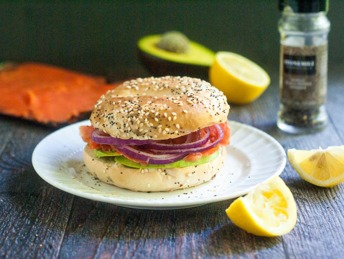 This smoked salmon bagel sandwich has it all. Lemons, smoked salmon, red onions, avocados all on an everything bagel.