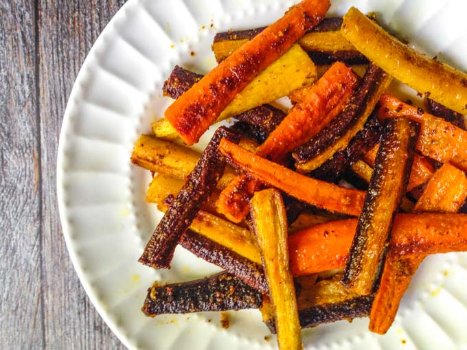 These colorful curried carrots are seasoned and roasted for maximum flavor. Spicy and cheesy, they make for the perfect side dish this fall.