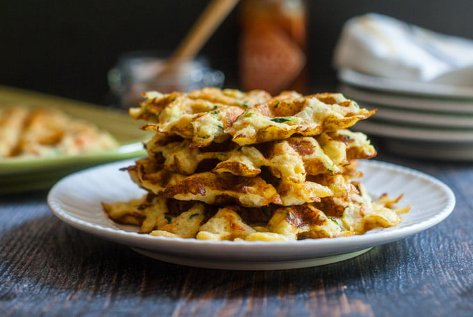 stack of zucchini & carrot low carb waffles on white plate