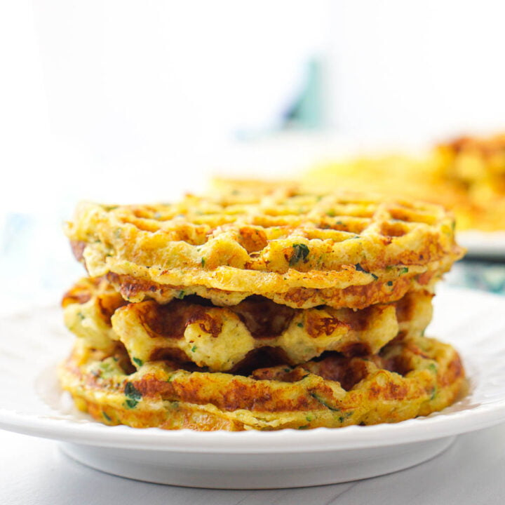 stack of keto vegetable waffles on white plate