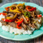 This hot pepper steak is an easy week night dinner that combines Asian flavors with hot peppers and steak. Serve over rice for a delicious family meal.