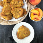 white plate with a low carb peach scone and text