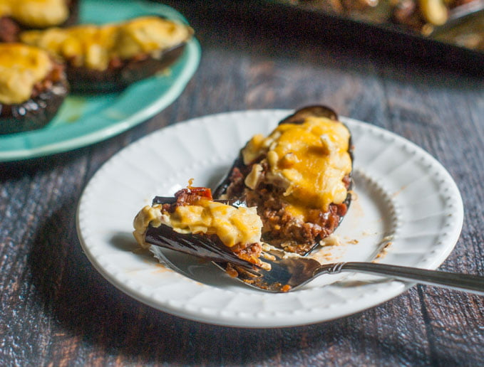 This stuffed eggplant with cauliflower cream sauce is a gluten free take on moussaka. Eggplant stuffed with seasoned meat and topped with a creamy cauliflower cheese sauce.