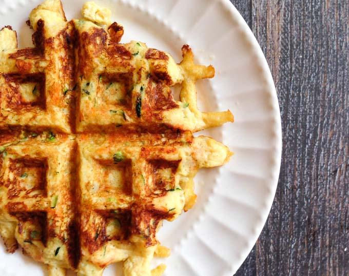zucchini & carrot waffle on white plate closeup