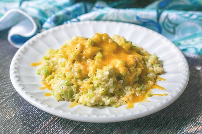 This cheesy broccoli cauliflower rice is a delicious side dish that you can make in minutes. It's low carb and grain free too with only 4.6g net carbs per serving!