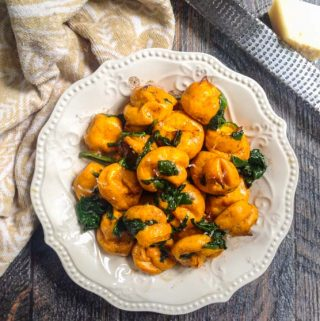 These gluten free butternut tots are half tot and half gnocchi and 100% delicious. Topped with browned butter, spinach and freshly grated asiago cheese for a delicious vegetarian meal.