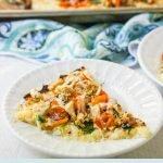 white plates with chicken & vegetable low carb pizza with text overlay