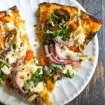 This chicken vegetable pizza is made with a cauliflower crust so it's gluten free as well as delicious!