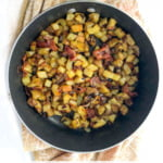 pan with German fried potatoes with bacon and text overlay
