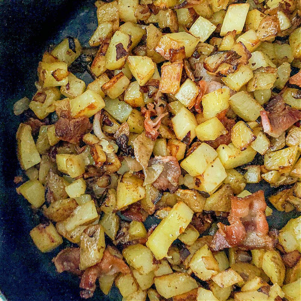 closeup of a pan of German fried potatoes with bacon