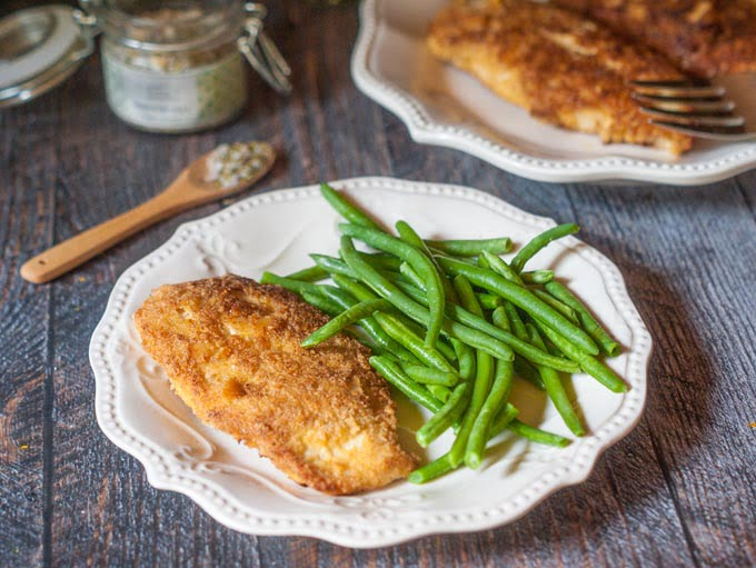 This Paleo coconut crusted chicken is a delicious and healthy dish you make in less than 30 minutes and has only 4.7g net carbs.