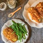This Paleo coconut crusted chicken is a delicious and healthy dish you make in less than 30 minutes.