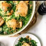 pan with creamy chicken thighs with spinach mushroom sauce and text overlay