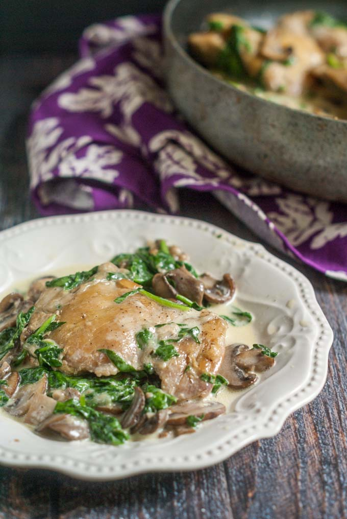 This creamy chicken skillet dinner with spinach & mushrooms is a delicious low carb meal you can make in under 40 minutes.