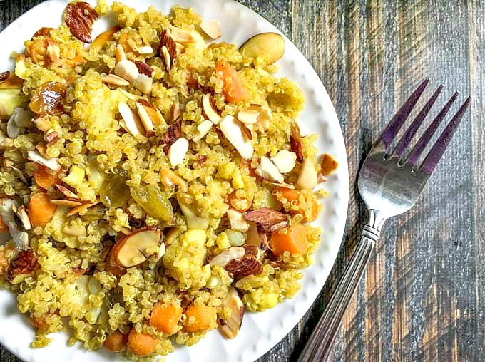 This curry vegetable quinoa pilaf is an easy and delicious side dish. This vegetarian dish only takes 15 minutes to make.