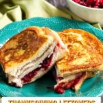 closeup of thanksgiving turkey leftovers sandwich on green plate with text overlay