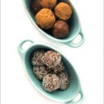 blue bowls with keto protein balls which are chocolate coconut flavored and text overlay