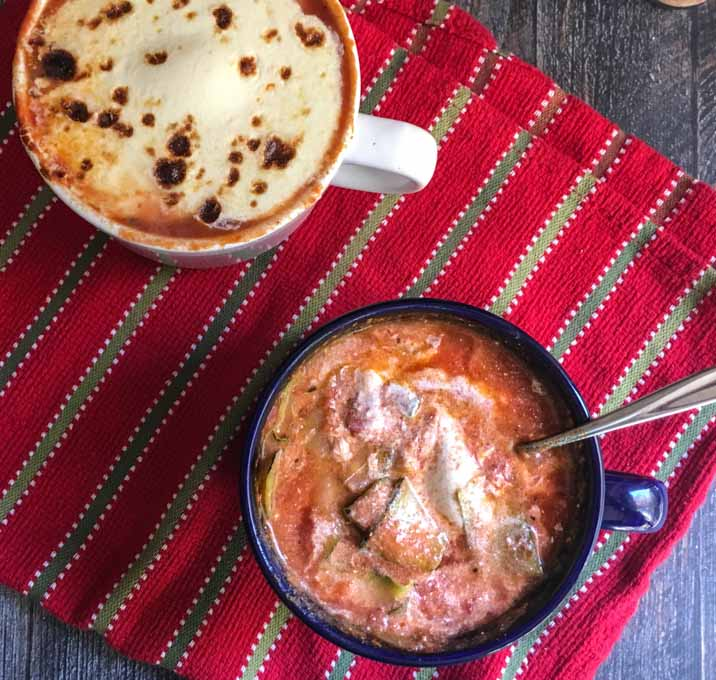 This easy zucchini lasagna soup is like eating a gluten free lasagna in a bowl. Meat sauce, zucchini and lots of cheesy goodness for a heart warming meal.