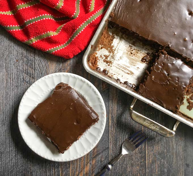 cookie sheet pan with a slice of sheet cake mixing and a fork