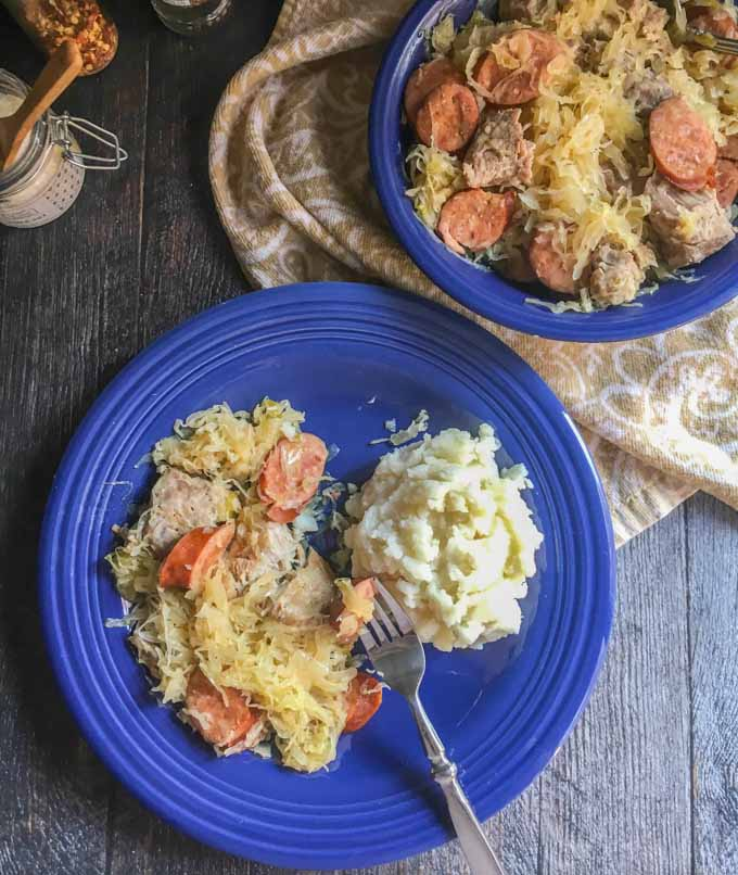 This New Year's pork & sauerkraut dish is an easy, traditional meal that you can make in the slow cooker or Instant Pot. Best way to start your New Year!