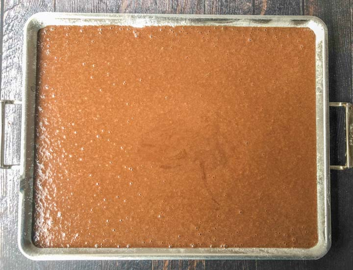 cake batter on a cookie sheet ready to go in the oven.