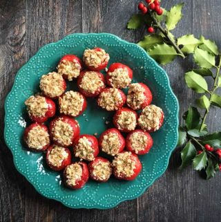These goat cheese & basil stuffed peppadews are an easy yet festive appetizer that are perfect for holiday parties!
