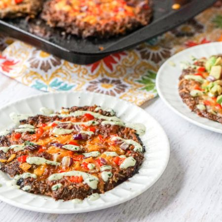 This low carb mini Mexican meatza recipe makes for a delicious lunch or dinner. Think taco meets burger meets pizza. Low carb and super tasty!
