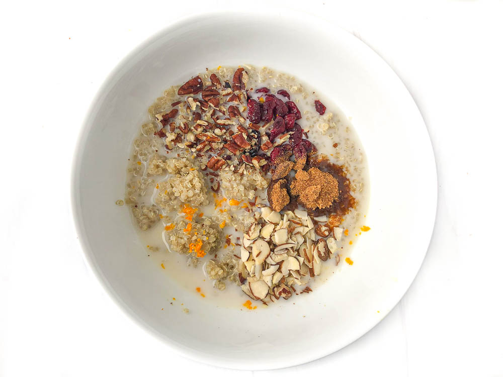 all the ingredients in a bowl with almond milk ready to cook