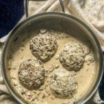 blute plate and skillet with keto burgers and creamy mushroom sauce with text