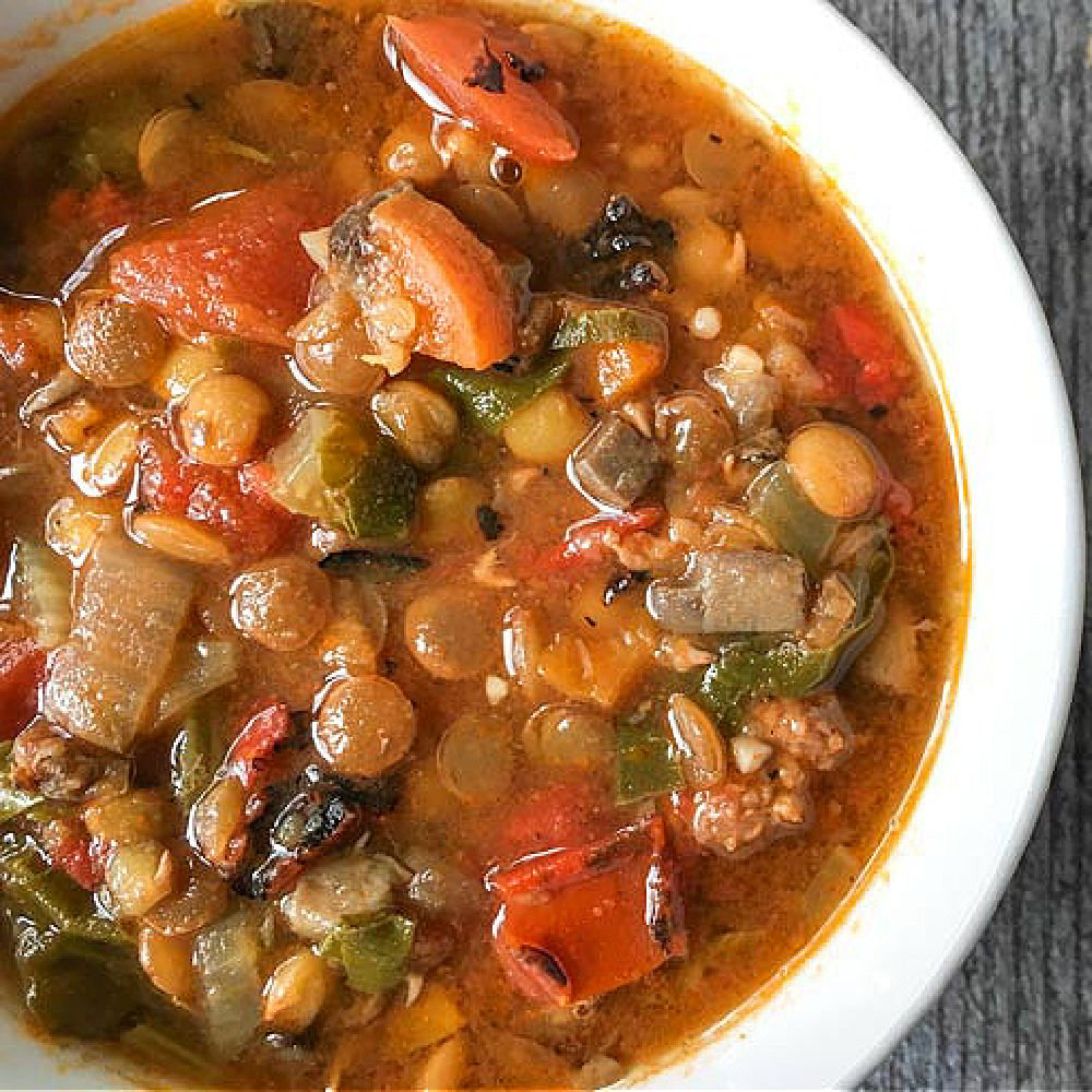 closeup of a bowl of lentil sausage soup made in the Instant pot