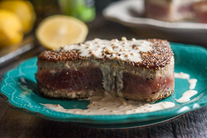 These peppered tuna steaks are easy but elegant. Meaty and tender they taste even better with a lemony dijon cream sauce for only 2.9g net carbs.