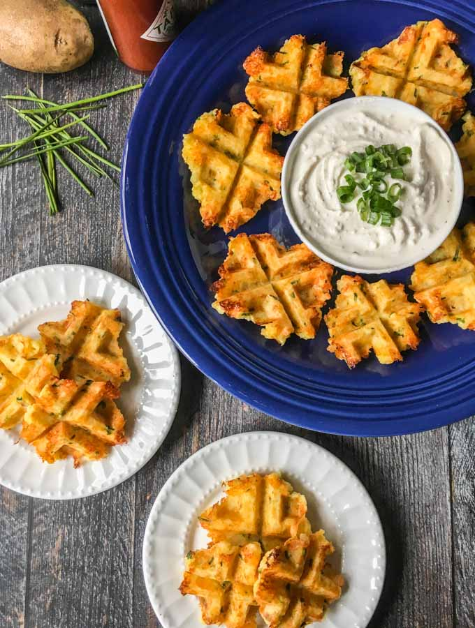 These potato & chive waffles are the perfect thing to take to the big game or your next party. Easy, delicious and gluten free, everyone will love them!