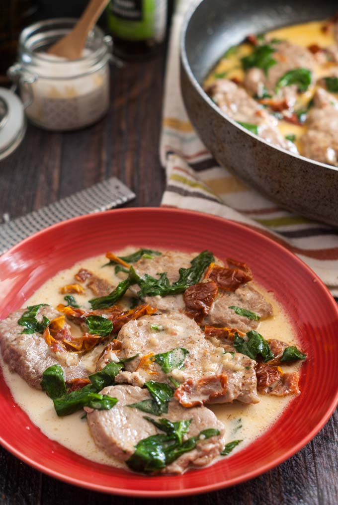 This tomato Asiago pork tenderloin is a rich and creamy skillet dinner that is only 3.6g net carbs per serving! Perfect for company, it takes 30 minutes start to finish.