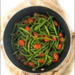 pan with tomatoes and green beans and text