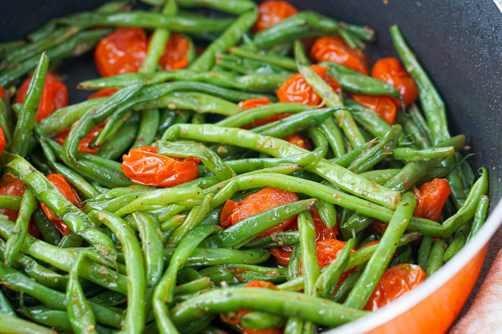 closeup of a pan of beans and tomatoes