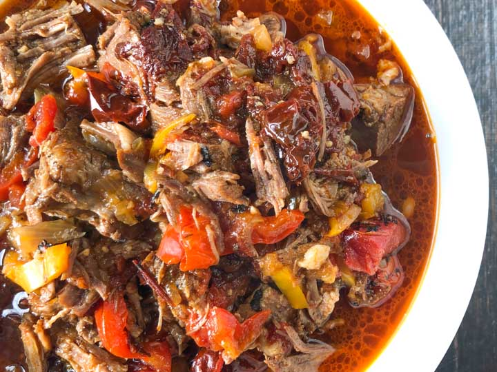 White bowl with spicy barbacoa beef