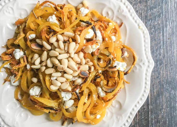 golden beet noodles with pine nuts & goat cheese closeup