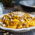 These golden beet noodles with pine nuts & goat cheese are so tasty you won't realize you are eating veggie noodles! And they take less that 20 minutes to make this gluten free, vegetarian dish! Easy, healthy, tasty.