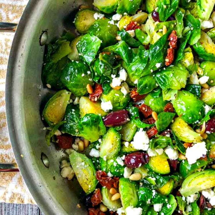 pan with keto Mediterranean Brussels sprouts - sprouts, feta cheese, sundried tomatoes, olives and pine nuts