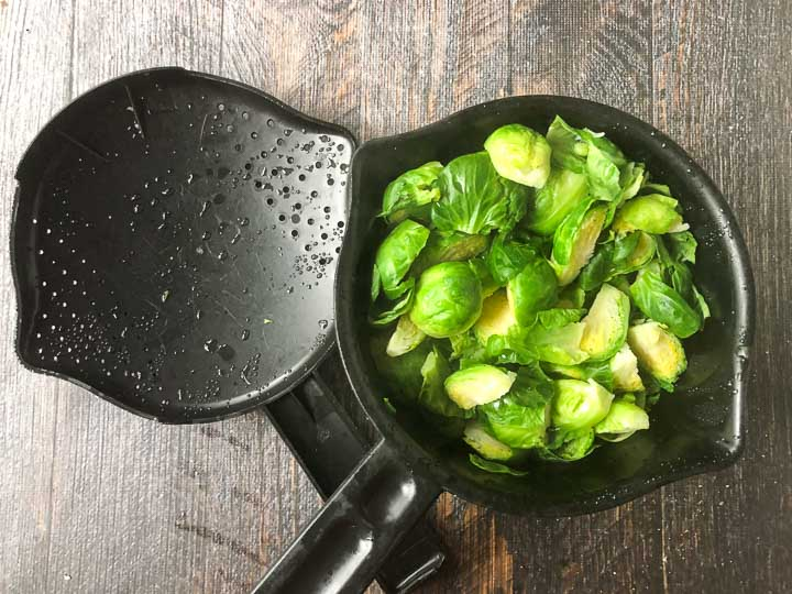 microwave pot with steamed Brussels sprouts