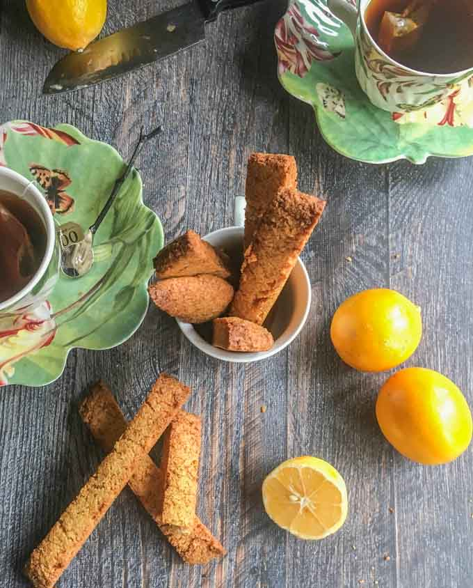 These Paleo Meyer lemon ginger biscotti are so easy to make and are gluten free. Fresh, Meyer lemon and spicy ginger are perfectly balanced with a hint of honey sweetness.