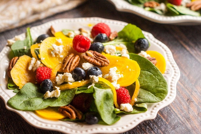 This pickled beet & gorgonzola spinach salad is full of delicious and nourishing ingredients such as berries, pecans and more.
