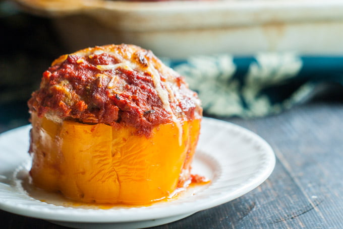 These cheesy meatball stuffed peppers are perfect for the meat lover. Mozzarella stuffed inside a huge meatball that's stuffed in a sweet bell pepper. Perfection!