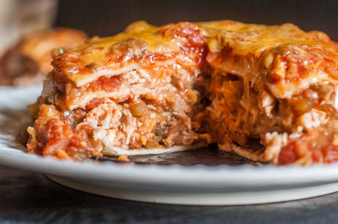 This chicken burrito lasagna is quick and easy in the Instant Pot and only takes 5 ingredients. It's like a big chicken burrito the whole family can share!
