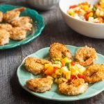 This Paleo coconut shrimp & pineapple mango salsa can be ready in less than 30 minutes. The bright, light fruit salsa, tastes delicious with the crunchy coconut shrimp!