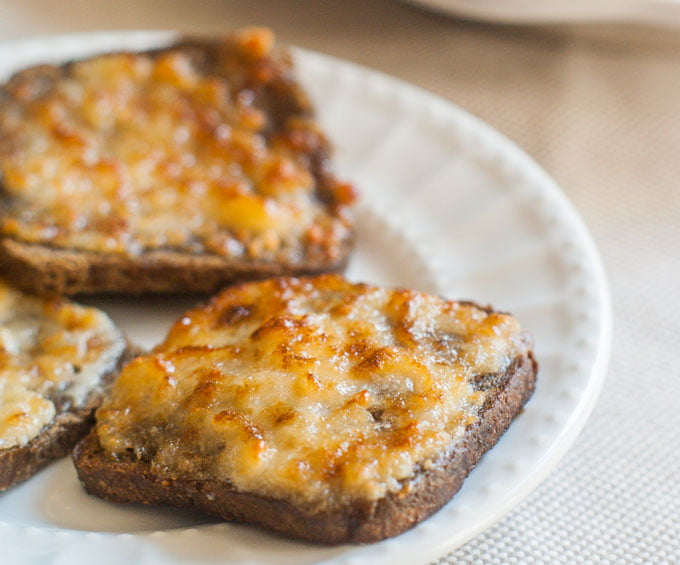 It's a retro party with Parmesan toast & rusty nail cocktails. Crunchy savory toasts are perfect with the sweet, aromatic rusty nail.