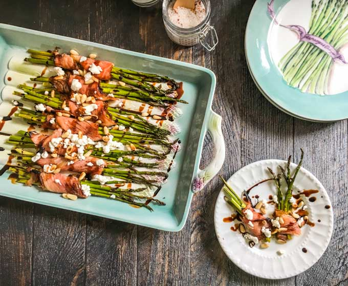This wrapped asparagus with goat cheese & balsamic glaze is an easy and elegant side dish with only 6 ingredients. Salty ham, creamy cheese, fresh asparagus topped with sweet glaze and crunchy pine nuts. Perfection!